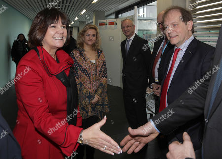 Stock Picture of Karen Pence, wife of United States Vice President Mike Pence, and her daughter Charlotte, second left, are greeted by University Chancellor Rik Torfs, right, upon their arrival at the Leuven University Hospital (UZ Leuven) in Belgium on