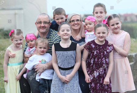Stock Photo of Parents Zoe and Ben Sullivan with twins Erin and Leah (both 1), twins Isabelle and Charlotte (both 8),  Elizabeth, 11, Olivia, 10, Noah, seven, Evangeline, five, and Tobias, four
