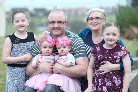 Parents Zoe and Ben Sullivan with twins Erin and Leah (both 1), twins Isabelle and Charlotte (both 8)