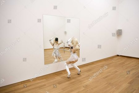 Stock Photo of The female figure of a dancing robot with face recognization capabilities by American artist Jordan Wolfson, is seen on show at the Stedelijk Museum in Amsterdam, The Netherlands, 20 February 2017. Wolfson explores ideas around the increasing digitalization of society and other technological developments.