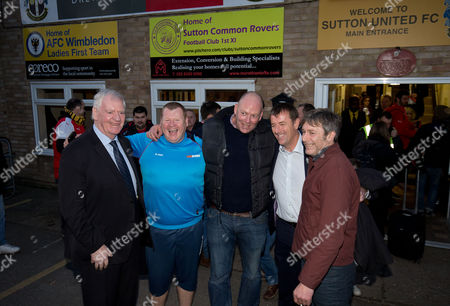 Matt Le Tissier (L) & Lawrie McMenemy (2nd R) pose with supporters & Goalkeeper Wayne Shaw of Sutton United (2nd L) arrive during the Emirates FA Cup 5th Round match between Sutton United and Arsenal at Borough Sports Ground, Gander Green Lane, Surrey on 20th February 2017