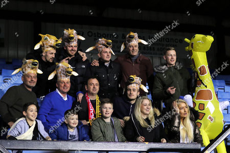 TV Presenter, Matt Allwright, with the scarf around his neck, sits with some Sutton fans pre-match during Sutton United  vs Arsenal, Emirates FA Cup Football at the Borough Sports Ground on 20th February 2017