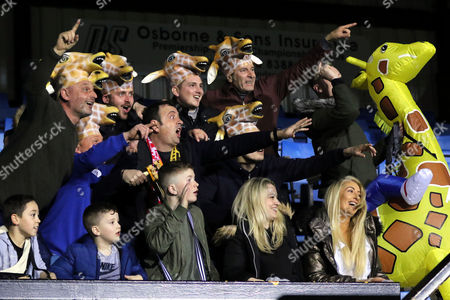 TV Presenter, Matt Allwright, with the scarf around his neck, shows the Sutton fans how to celebrate for the TV cameras during Sutton United  vs Arsenal, Emirates FA Cup Football at the Borough Sports Ground on 20th February 2017