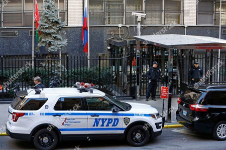New York City police officers and a patrol car are stationed outside the Russian Mission to the United Nations with flags at half staff, in New York, in the wake of the death of Vitaly Churkin, Russia's ambassador to the United Nations. Russian officials said Churkin died suddenly in New York on Monday