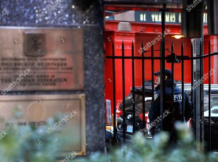 A police officer stands guard at the entrance to the Russian Mission to the United Nations, in New York. Vitaly Churkin, Russia's ambassador to the U.N., fell ill Monday in his office and later died