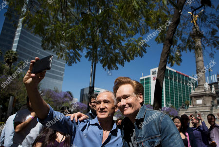 """Jorge Ramos, Conan O'Brien Television host Conan O'Brien, right, poses for a photo with Mexican-born, U.S.-based journalist Jorge Ramos as they walk along Paseo de la Reforma in Mexico City, . O'Brien is drawing stares in Mexico, where he's taping an episode of his show in a bid to """"do something positive"""" after the tensing of U.S.-Mexico relations"""
