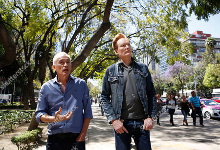 """Jorge Ramos, Conan O'Brien Mexican-born, U.S.-based journalist Jorge Ramos, left, tells television host Conan O'Brien how the Angel of Independence monument symbolizes a Mexican national identity distinct from its neighbor to the north, as they walk along Paseo de la Reforma, in Mexico City, . O'Brien is drawing stares in Mexico, where he's taping an episode of his show in a bid to """"do something positive"""" after the tensing of U.S.-Mexico relations"""