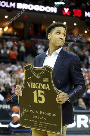 Stock Picture of Malcolm Brogdon is recognized during a ceremony to retire his number before the start of an NCAA college basketball game against Miami, in Charlottesville, Va
