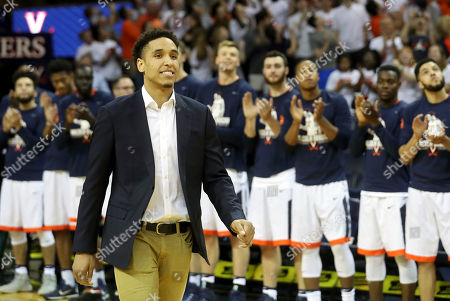 Stock Photo of Malcolm Brogdon is introduced during a ceremony to retire his number before the start of an NCAA college basketball game against Miami, in Charlottesville, Va