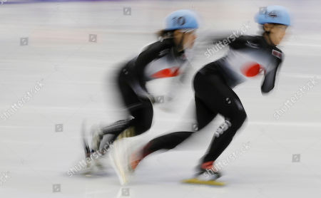 Ayako Ito, Sumire Kikuchi Ayako Ito, right, of Japan and her compatriot Sumire Kikuchi, left, compete during the women's 500 meters quarterfinals of short track speed skating competition at the Asian Winter Games at Makomanai Indoor Skating Rink in Sapporo, northern Japan