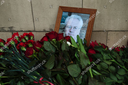 Flowers are placed to a portrait of the late Russian Ambassador to the United Nations Vitaly Churkin outside the Foreign Ministry headquarters in Moscow, Russia, . Churkin died suddenly Monday after falling ill at his office at Russia's U.N. mission is being remembered by his diplomatic colleagues as a powerful and passionate voice for his nation