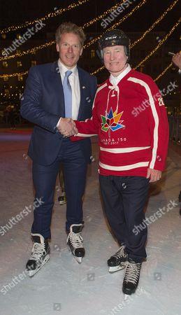 Stock Photo of David Johnston, Governor General of Canada, Daniel Alfredsson, skating in Kungsträdgården, Stockholm