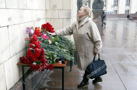 A woman lays flowers to pay last respect to late Russian Permanent Representative to the United Nations Vitaly Churkin at the Foreign Ministry headquarters in Moscow, Russia, 21 February 2017. Vitaly Churkin died suddenly in New York on 20 February.