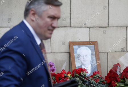 A man in front of a portrait of late Russian Permanent Representative to the United Nations Vitaly Churkin at the Foreign Ministry headquarters in Moscow, Russia, 21 February 2017. Vitaly Churkin died suddenly in New York on 20 February.
