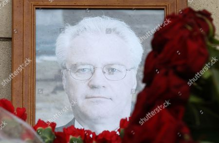 Flowers are placed near a portrait of late Russian Permanent Representative to the United Nations Vitaly Churkin at the Foreign Ministry headquarters in Moscow, Russia, 21 February 2017. Vitaly Churkin died suddenly in New York on 20 February.