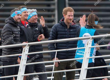 Steve Cram, Jonathan Edwards and Prince Harry during a marathon training session on the Quayside