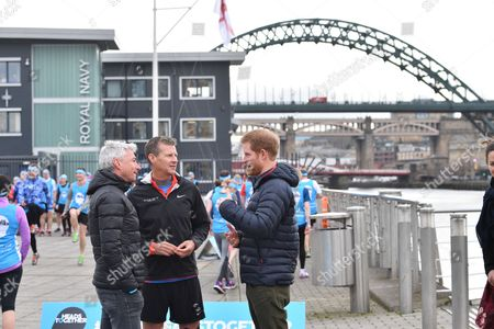 Jonathan Edwards, Steve Cram and Prince Harry at a Team Heads Together marathon training session at the Quayside