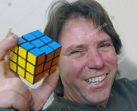 45-year-old Graham Parker with the completed Rubik's Cube
