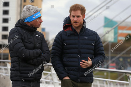 Prince Harry (R) and English former triple-jumper Jonathan Edwards attend (L) a training session for runners taking part in the 2017 Virgin Money London Marathon for Heads Together, the official Charity of the Year, in Newcastle