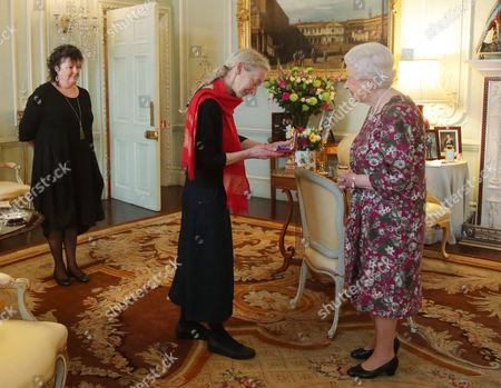 Gillian Allnutt (centre) is presented with The Queen's Gold Medal for Poetry by Queen Elizabeth II, as Poet Laureate Carol Ann Duffy looks on, at Buckingham Palace, London.