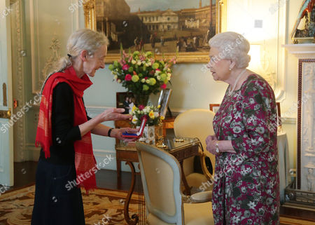 Stock Picture of Gillian Allnutt is presented with The Queen's Gold Medal for Poetry by Queen Elizabeth II at Buckingham Palace, London.