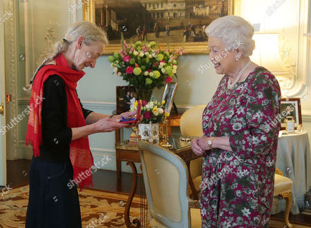 Stock Image of Gillian Allnutt is presented with The Queen's Gold Medal for Poetry by Queen Elizabeth II at Buckingham Palace, London.