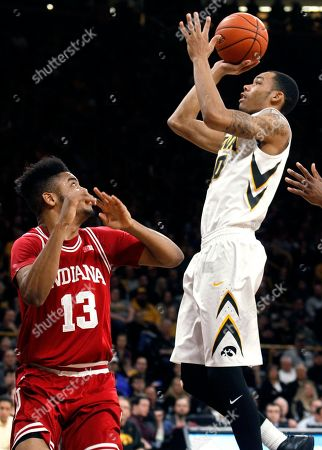 Christian Williams, Juwan Morgan Iowa's Christian Williams (10) shoots in front of Indiana's Juwan Morgan (13) during the second half of an NCAA college basketball game, in Iowa City, Iowa