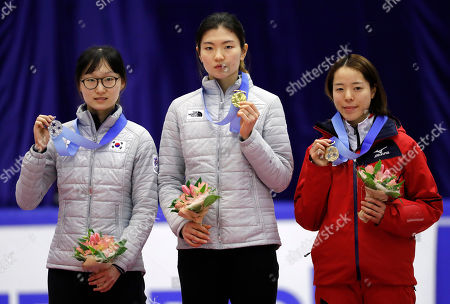 Shim Suk-hee, Choi Min-jeong, Sumire Kikuchi Gold medalist Shim Suk-hee, center, of South Korea is flanked by silver medalist Choi Min-jeong, left, of South Korea and bronze medalist Sumire Kikuchi, right, of Japan during the victory ceremony of the women's 1000 meters of short track speed skating competition at the Asian Winter Games at Makomanai Indoor Skating Rink in Sapporo, northern Japan