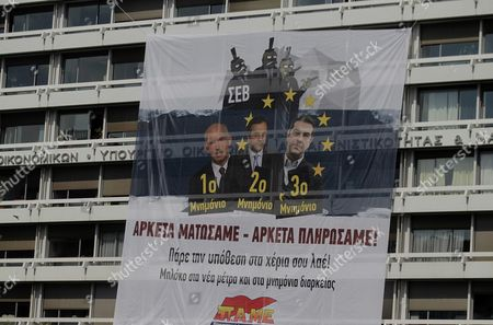 A Banner Placed by Protesters of the Communist-affiliated Trade Union Pame Hangs On the Building of Finance Ministry During an Anti-austerity and Anti-government Protest in Athens Greece 11 June 2015 the Banner Depicts Greek Premier Alexis Tsipras and the Former Prime Ministers Antonis Samaras and George Papandreou and Reads 'Enough Blood We Have Shed Enough We Have Paid ' the Greek Government is Requesting an Extension of the Current Loan Agreement by Nine Months to Ensure the Funding of the Greek Economy Government Sources in Brussels Said On 10 June 2015