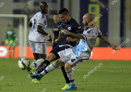 Stock Image of Atromitos' Fernando Godoy (c) Challenges Fenerbahce's Raul Meireles (r) During the Uefa Europa League Play Offs Soccer Match Between Atromitos and Fenerbahce in Athens Greece 20 August 2015