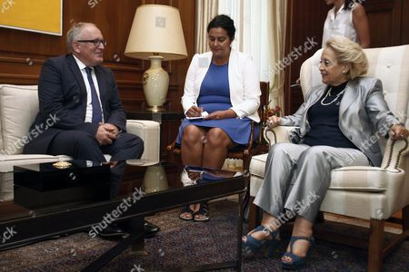 Greek Caretaker Prime Minister Vassiliki Thanou (r) Talks with Vice-president of the European Commission Frans Timmermans (l) and the Commissioner For Migration Home Affairs and Citizenship Dimitris Avramopoulos (not Pictured) During Their Meeting in Maximos Mansion in Athens Greece 03 September 2015 the European Officials Will Take Part in a Meeting with Caretaker Prime Minister Vassiliki Thanou and Four Ministers in Order to Set Up a Coordinating Center in Piraeus with Aim the Acceleration of the Management of the Migration Flow and On 04 September Morning They Will Visit the Island of Kos where They Will Give a Press Conference