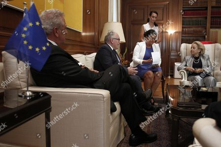 Greece's Caretaker Prime Minister Vassiliki Thanou (r) Talks with Vice-president of the European Commission Frans Timmermans (2l) and the Commissioner For Migration Home Affairs and Citizenship Dimitris Avramopoulos (l) During Their Meeting in Maximos Mansion in Athens Greece 03 September 2015 the European Officials Will Take Part in a Meeting with Caretaker Prime Minister Vassiliki Thanou and Four Ministers in Order to Set Up a Coordinating Center in Piraeus with Aim the Acceleration of the Management of the Migration Flow and On Friday Morning They Will Visit the Island of Kos where They Will Give a Press Conference