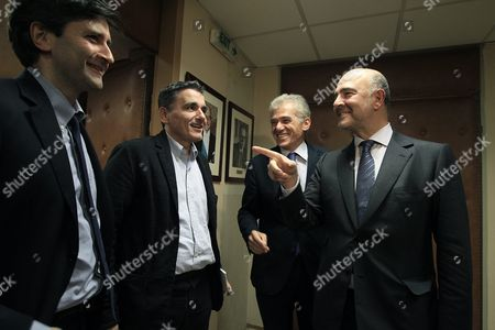 European Commissioner For Economic and Financial Affairs Pierre Moscovici (r) Jokes with Greek Finance Minister Euclid Tsakalotos (2-l) and Alternate Finance Minister George Chouliarakis (l) During a Meeting at the Finance Ministry in Athens Greece 03 November 2015 Moscovici is Paying a Two-day Visit in Athens in Order to Meet with Government Officials and Be Briefed On the Implementation of the Greek Programme Others Are not Identified