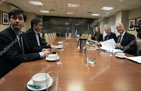 European Commissioner For Economic and Financial Affairs Pierre Moscovici (r) Chats with Greek Finance Minister Euclid Tsakalotos (2-l) and Alternate Finance Minister George Chouliarakis (l) During a Meeting at the Finance Ministry in Athens Greece 03 November 2015 Moscovici is Paying a Two-day Visit in Athens in Order to Meet with Government Officials and Be Briefed On the Implementation of the Greek Programme Others Are not Identified