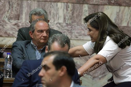 Former Prime Minister of Greece Costas Karamanlis (l) Talks with Dora Bakoyanni (r) in the Greek Parliament During the Speech of the Leader of New Democracy Opposition Party Antonis Samaras (not Pictured) Athens Greece 29 June 2015 Regarding Prime Minister's Alexis Tsipras (not Pictured) Referendum On Bailout Terms to Be Held On the 05 July 2015