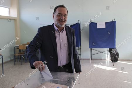 Panagiotis Lafazanis Former Energy Minister of the Coalition Government of the Syriza Party and Leader of the New 'Popular Unity' Party Casts His Ballot During the Parliamentary Elections in Athens Greece 20 September 2015 Greek Voters Take to the Polls Throughout Greece in General Elections After Prime Minister Tsipras Resigned On 20 August 2015