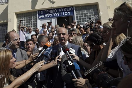 Leader of Main Opposition Consernative 'New Democracy' Party Evangelos Meimarakis (c) Makes Statements to Reporters As He Leaves an Election Center in Athens Greece 20 September 2015 Greek Voters Take to the Polls Throughout Greece in General Elections After Prime Minister Tsipras Resigned On 20 August 2015