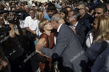 A Supporter Kisses the Leader of Main Opposition Consernative 'New Democracy' Party Evangelos Meimarakis (central R) As He Leaves an Election Center in Athens Greece 20 September 2015 Greek Voters Take to the Polls Throughout Greece in General Elections After Prime Minister Tsipras Resigned On 20 August 2015