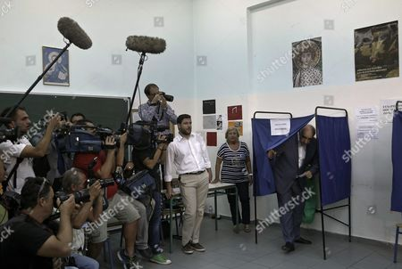 Leader of Main Opposition Consernative 'New Democracy' Party Evangelos Meimarakis (r) Exits a Voting Booth to Casts His Ballot at a Election Center in Athens Greece 20 September 2015 Greek Voters Take to the Polls Throughout Greece in General Elections After Prime Minister Tsipras Resigned On 20 August 2015