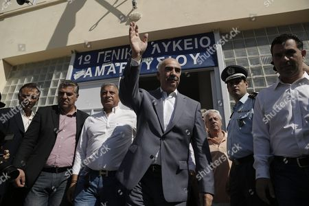 Leader of Main Opposition Consernative 'New Democracy' Party Evangelos Meimarakis (c) Waves to Supporters As He Leaves an Election Center in Athens Greece 20 September 2015 Greek Voters Take to the Polls Throughout Greece in General Elections After Prime Minister Tsipras Resigned On 20 August 2015