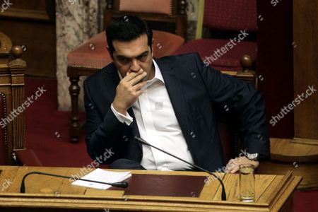 Greek Prime Minister Alexis Tsipras Attends the Speech of Leader of Main Opposition Conservative 'New Democracy' Party Evangelos Meimarakis (not Pictured) Before the Confidence Vote at the Parliament in Athens Greece 07 October 2015