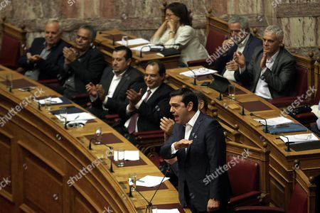 Greek Prime Minister Alexis Tsipras (l) Answers After the Speech of Leader of Main Opposition Conservative 'New Democracy' Party Evangelos Meimarakis(not Pictured) Before the Confidence Vote at the Parliament in Athens Greece 07 October 2015