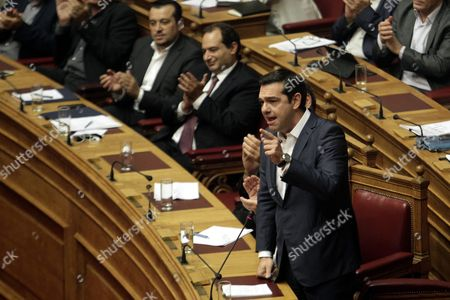 Greek Prime Minister Alexis Tsipras (l) Answers After the Speech of Leader of Main Opposition Conservative 'New Democracy' Party Evangelos Meimarakis (not Pictured) Before the Confidence Vote at the Parliament in Athens Greece 07 October 2015
