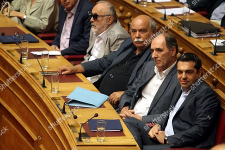 Greek Prime Minister Alexis Tsipras Attends a Discussion at the Parliament in Athens Greece 14 August 2015 a Vote Expected Early 14 August in the Greek Parliament On the Country's Third Bailout Agreement in Five Years is Being Closely Watched not Only Because It Could Assuage the Country's Economic Turmoil But Also Unleash Political Ferment the Committees Decided That the Draft Law On Greece's Agreement with Its Lenders Will Be Voted Under Fast-track Procedures Requested by the Government the Vote Had Been Expected Thursday But Parliament President Zoe Konstantopoulou Delayed a Debate Over the Bailout in the Finance Committee From 12 Until 13 August Morning Which Was Also Expected to Delay the Debate and Vote in the Full Parliament