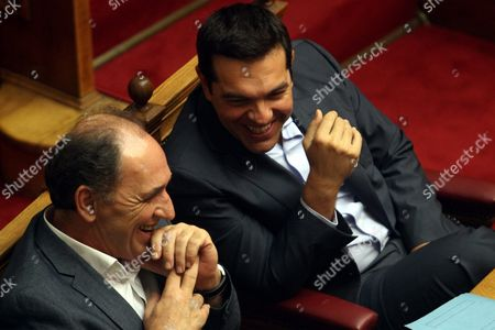 Greek Prime Minister Alexis Tsipras (r) Talks with Minister of Economy Infastructure Shipping and Tourism George Stathakis (l) at the Parliament in Athens Greece 14 August 2015 a Vote Expected Early 14 August in the Greek Parliament On the Country's Third Bailout Agreement in Five Years is Being Closely Watched not Only Because It Could Assuage the Country's Economic Turmoil But Also Unleash Political Ferment the Committees Decided That the Draft Law On Greece's Agreement with Its Lenders Will Be Voted Under Fast-track Procedures Requested by the Government the Vote Had Been Expected Thursday But Parliament President Zoe Konstantopoulou Delayed a Debate Over the Bailout in the Finance Committee From 12 Until 13 August Morning Which Was Also Expected to Delay the Debate and Vote in the Full Parliament