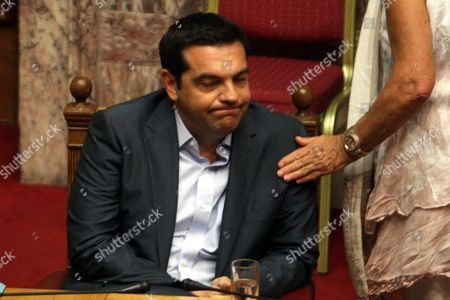 Greek Prime Minister Alexis Tsipras Reacts As He Attends a Discusision at the Parliament in Athens Greece 14 August 2015 a Vote Expected Early 14 August in the Greek Parliament On the Country's Third Bailout Agreement in Five Years is Being Closely Watched not Only Because It Could Assuage the Country's Economic Turmoil But Also Unleash Political Ferment the Committees Decided That the Draft Law On Greece's Agreement with Its Lenders Will Be Voted Under Fast-track Procedures Requested by the Government the Vote Had Been Expected Thursday But Parliament President Zoe Konstantopoulou Delayed a Debate Over the Bailout in the Finance Committee From 12 Until 13 August Morning Which Was Also Expected to Delay the Debate and Vote in the Full Parliament