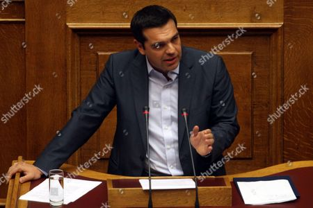 Greek Prime Minister Alexis Tsipras Adresses the Parliament in Athens Greece 14 August 2015 a Vote Expected Early 14 August in the Greek Parliament On the Country's Third Bailout Agreement in Five Years is Being Closely Watched not Only Because It Could Assuage the Country's Economic Turmoil But Also Unleash Political Ferment the Committees Decided That the Draft Law On Greece's Agreement with Its Lenders Will Be Voted Under Fast-track Procedures Requested by the Government the Vote Had Been Expected Thursday But Parliament President Zoe Konstantopoulou Delayed a Debate Over the Bailout in the Finance Committee From 12 Until 13 August Morning Which Was Also Expected to Delay the Debate and Vote in the Full Parliament