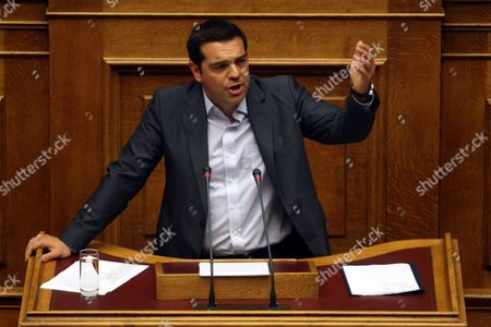 Greek Prime Minister Alexis Tsipras Gestures As He Adresses the Parliament in Athens Greece 14 August 2015 a Vote Expected Early 14 August in the Greek Parliament On the Country's Third Bailout Agreement in Five Years is Being Closely Watched not Only Because It Could Assuage the Country's Economic Turmoil But Also Unleash Political Ferment the Committees Decided That the Draft Law On Greece's Agreement with Its Lenders Will Be Voted Under Fast-track Procedures Requested by the Government the Vote Had Been Expected Thursday But Parliament President Zoe Konstantopoulou Delayed a Debate Over the Bailout in the Finance Committee From 12 Until 13 August Morning Which Was Also Expected to Delay the Debate and Vote in the Full Parliament