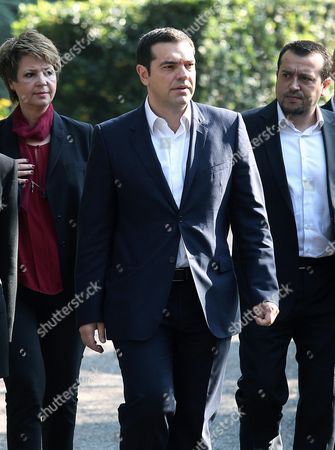 Greek Prime Minister Alexis Tsipras (c) Exits the Presidential Palace After a Meeting with President Karolos Papoulias in Athens Greece 20 November 2015 the Government's Omnibus Bill On Prior Actions Was Approved by the Greek Parliament On Thursday Evening with 153 Votes in Favour and 137 Votes Against the Legislation