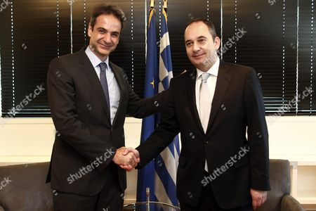 Outgoing President of New Democracy Party Yiannis Plakiotakis (r) Welcomes Newly Elected President Kyriakos Mitsotakis (l) During Their Meeting at the Headquarters of the Party in Athens Greece 11 January 2016 Kyriakos Mitsotakis Was Elected President of Main Opposition New Democracy (nd) in Runoff Elections On 10 January Defeating Vangelis Meimarakis Who Had Served As Interim Party Leader Over the Summer After Antonis Samaras Stepped Down